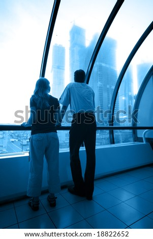 business interior in blue and man and woman