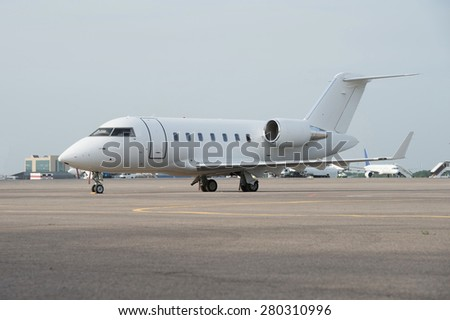 Business jet airplane on the ground.