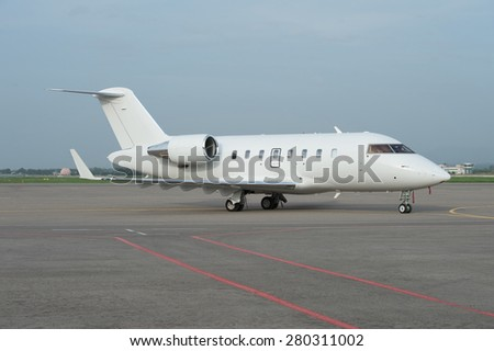 Business jet airplane on the ground - stock photo
