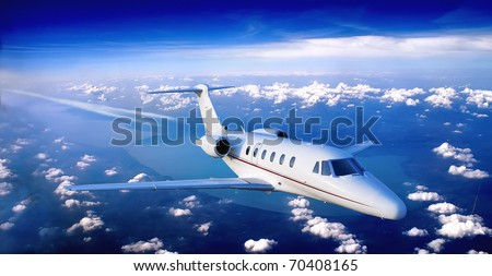 business jet flying above a lake - stock photo