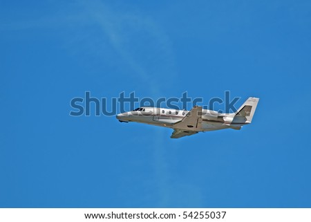 Business jet in thr blue sky