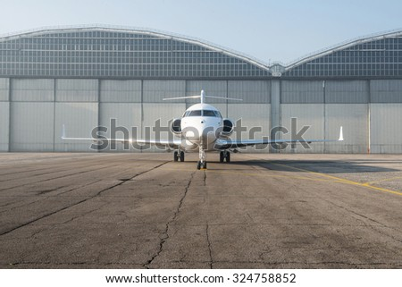 Business jet plane on the ground. - stock photo