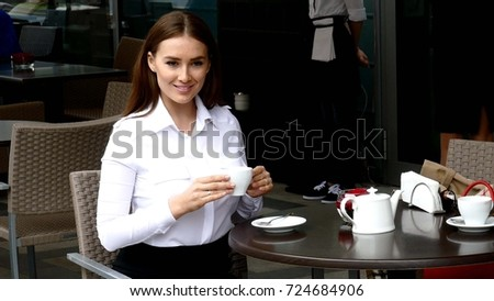 Business lady drinking coffee in cafe