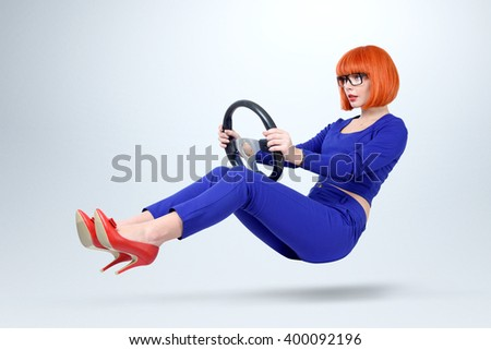 Business lady in blue driver car with a wheel, woman driving concept - stock photo