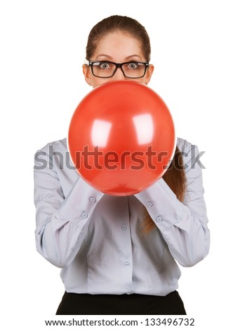 Business lady in glasses inflates a red ball
