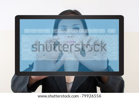 Business lady pressing transparent keyboard on the tablet screen. - stock photo