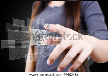 Business lady pushing Social Network button. - stock photo