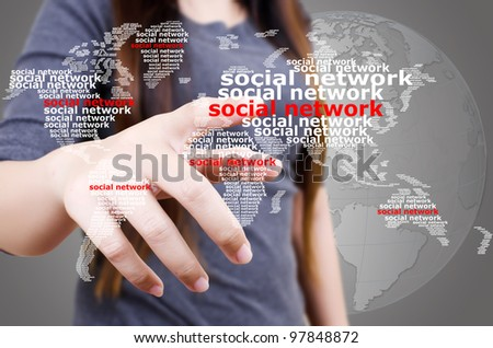 Business lady pushing Social Network world map. - stock photo