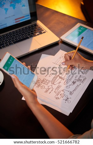 Business lady using smartphine when working on business idea