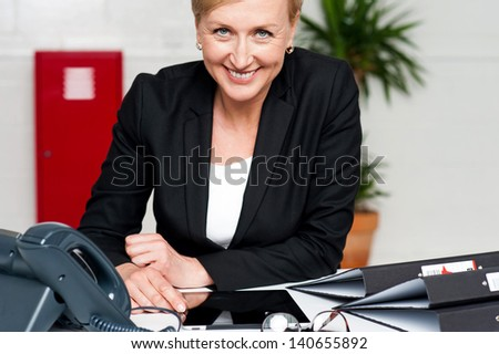 Business lady working with touch pad at her work desk - stock photo