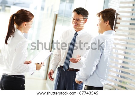 Business leader explaining to his employees their tasks - stock photo