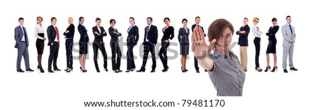 Business leader making a stop gesture with her team behind, isolated