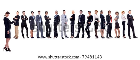 business leader presenting her successful business team - stock photo
