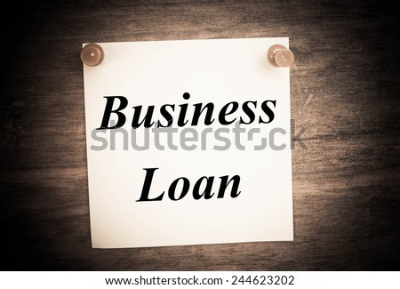 business loan text concept on note paper  - stock photo