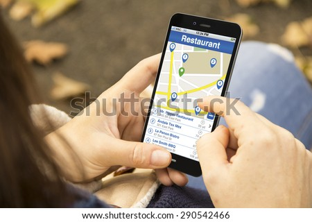 business location search concept: young woman searchin for a restaurant in a 3d generated smartphone. Screen graphics are made up - stock photo