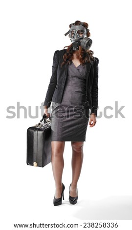 Business looking young adult woman wearing a personal gas mask and she have a briefcase - white background - stock photo