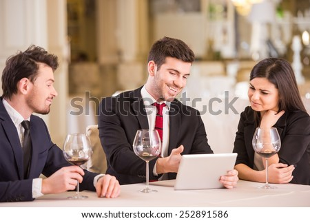 Business lunch. Business partners are meeting in restaurant to discuss plan of work. - stock photo