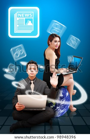 Business man and beautiful lady present the News icon from Globe : Elements of this image furnished by NASA
