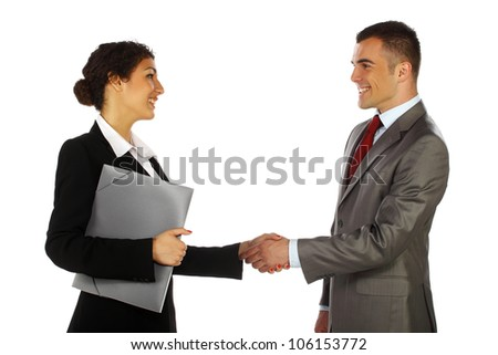 Business man and business women smiling and shaking hands - stock photo