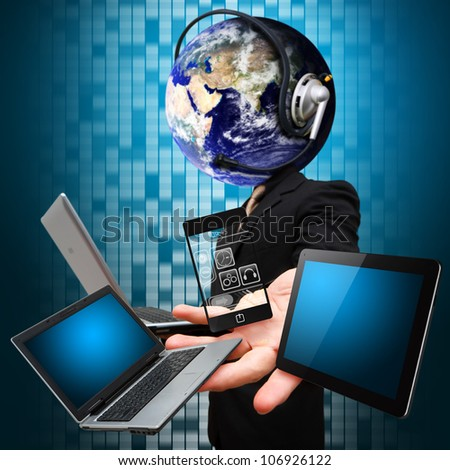 Business man and digital devices : Elements of this image furnished by NASA - stock photo