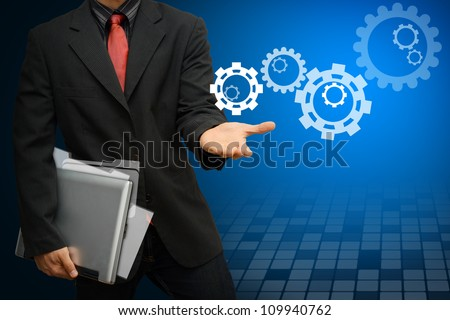 Business man and Gear to success - stock photo