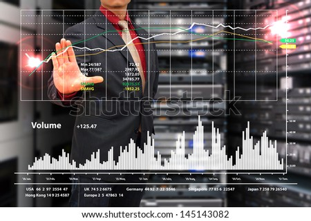Business man and graph monitor the system - stock photo