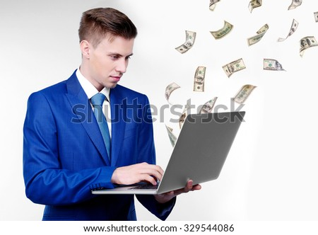 Business man and money fly out of laptop screen - stock photo