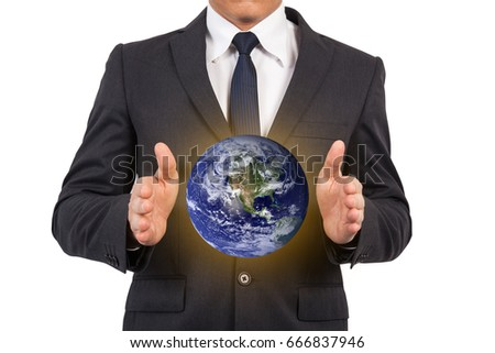 Business man and the world in hand. Elements of this image furnished by NASA.