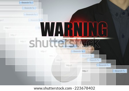 Business man and warning message on computer. - stock photo