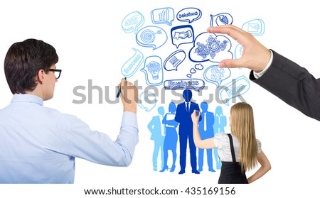 Business man and woman drawing people silhouettes and business related icons on white background. Concept of teamwork, partnership and HR - stock photo