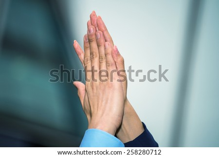 Business man and woman giving five, hands detail. - stock photo