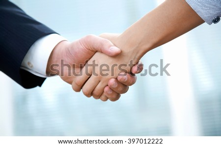 Business man and woman hand shaking at a meeting - stock photo