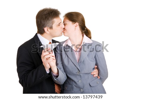 business man and woman kissing with paper airplane in hands - stock photo
