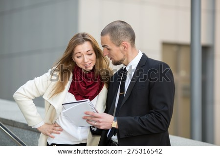 Business man and woman on background blurred building office center, during a business meeting. Business hours. Students intern. Business people - man and woman. Successful group of business people.  - stock photo