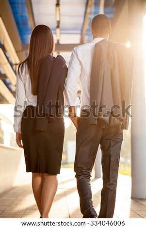 business man and woman on break ,walking around  - stock photo