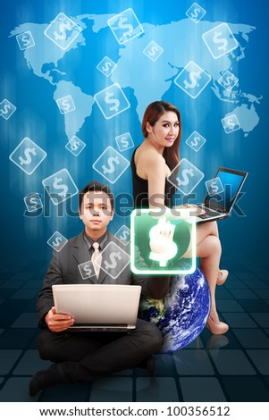 Business man and woman present the money icons on world map : Elements of this image furnished by NASA