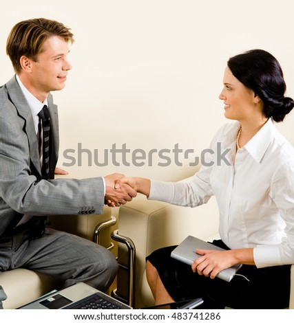Business man and woman shaking hands making an agreement