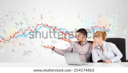 Business man and woman sitting at table with stock market graph 3d letters  - stock photo