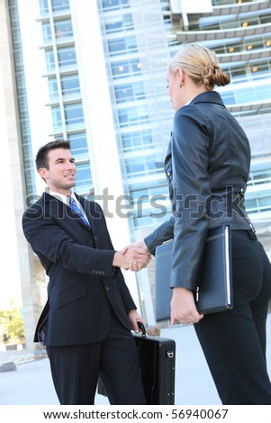 Business man and woman team at office handshake - stock photo