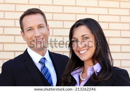 Business Man and Woman Team Smiling and Wearing Suits and Looking at the Camera and Happy and Working - stock photo