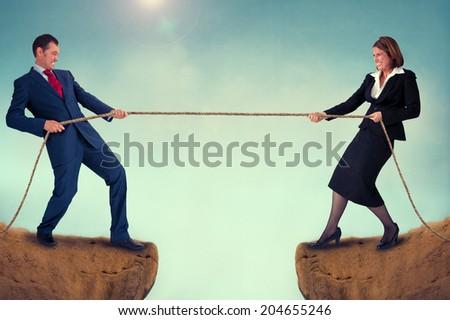 business man and woman tug of war challenge - stock photo