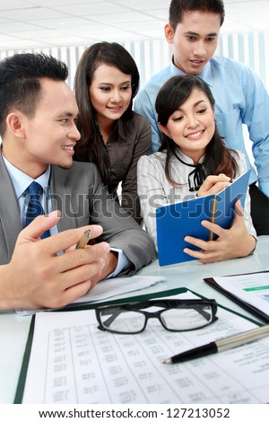 business man and woman working on meeting in the office - stock photo
