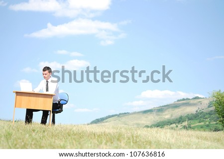 Business man at desk in nature