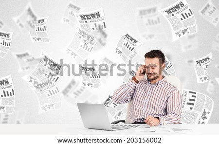 Business man at desk with stock market newspapers concept - stock photo