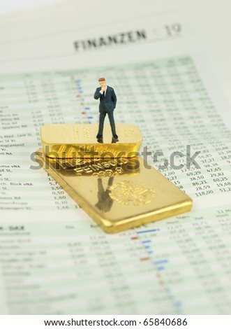 Business man at gold bars - stock photo