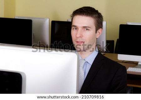 Business man at workplaces in computer room - stock photo