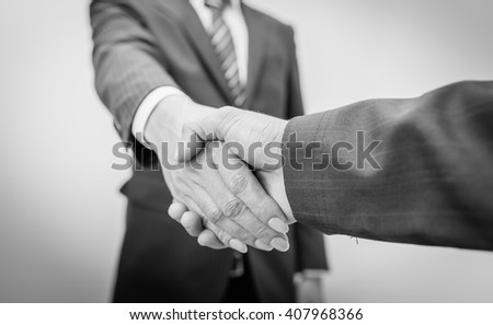Business Man. Business handshake and business people , black and white. - stock photo