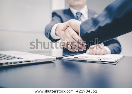 Business Man. Business handshake and business people.  Shake hands in office.  - stock photo