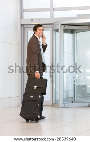 business man carrying luggage - stock photo