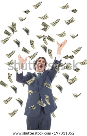 business man catching falling dollars banknotes and screaming, angry stressed man grabbing flying money - stock photo